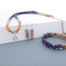 Load image into Gallery viewer, Gemstone jewellery set, Twilight by Pellara. Made of Silver, Sunstone, Moonstone, Blue Tiger Eye and Sodalite, Snowflake pendant