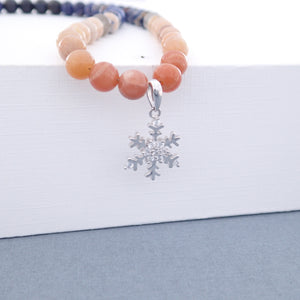 Gemstone jewellery set, Twilight by Pellara. Made of Silver, Sunstone, Moonstone, Blue Tiger Eye and Sodalite, Snowflake pendant