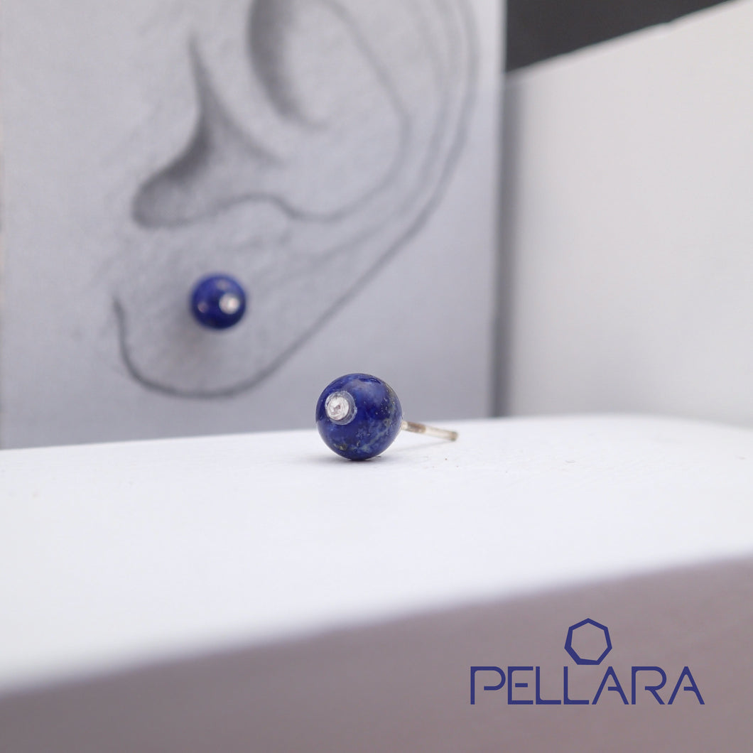 Sterling silver natural gemstone stud earrings contains a sparkling piece of Cubic Zirconia. Very light and hypo-allergenic, 6mm or 8mm beads. Lapis Lazuli