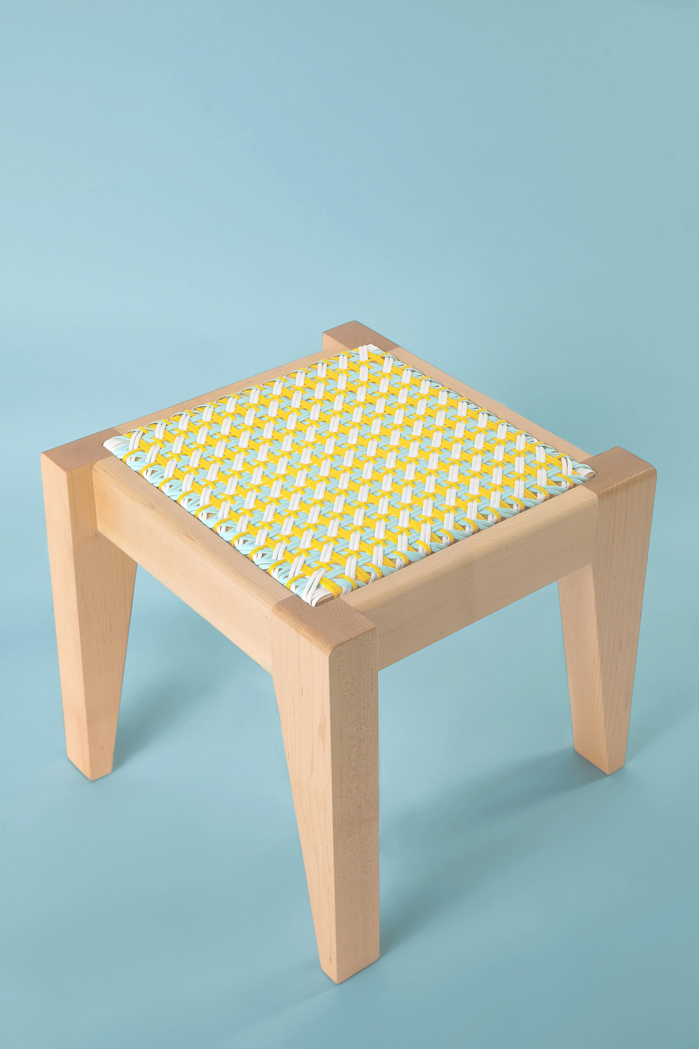 Elias stool form the Beiruti collection of caned timber chairs made in Lebanon designed by Adam Nathaniel Furman
