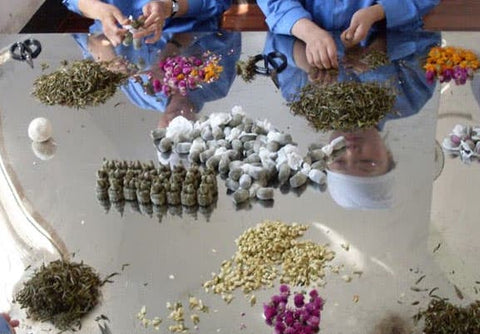 Blooming Tea Being Made by Hand