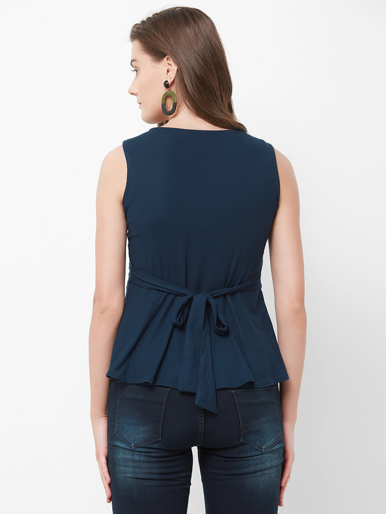 SLEEVELESS TOP WITH WAIST TIEUP