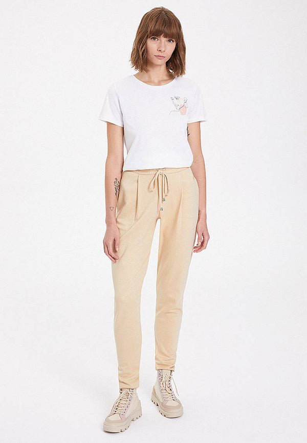 ESSENTIALS TAPPERED JOGGER in Semolina