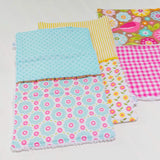 modern-burp-cloth-set-pink-yellow-aqua-flowers