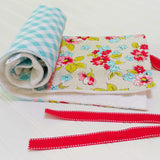 aqua-gingham-red-flowers-baby-changing-pad