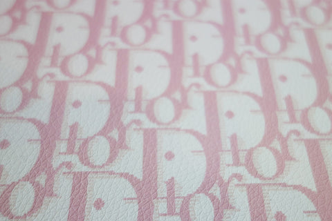 White synthetic leather with baby pink CD monogram print