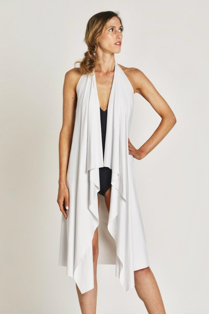 light gray white strand wrap worn as open coverup