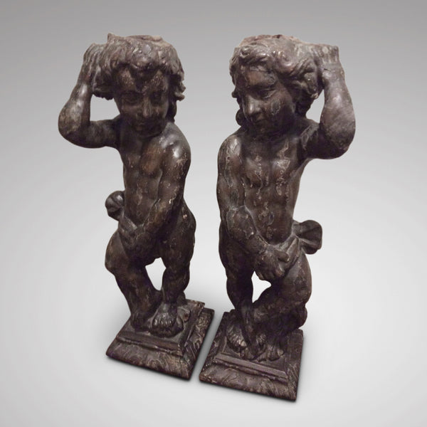 Pair of carved oak cherubs