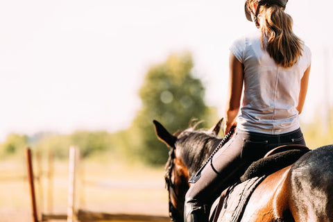 Woman horse back riding