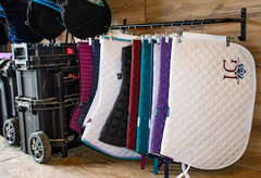 You can also use blanket bars and hangers to hang your saddle pads and blankets.