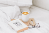 Book Latte And Glasses On Bed