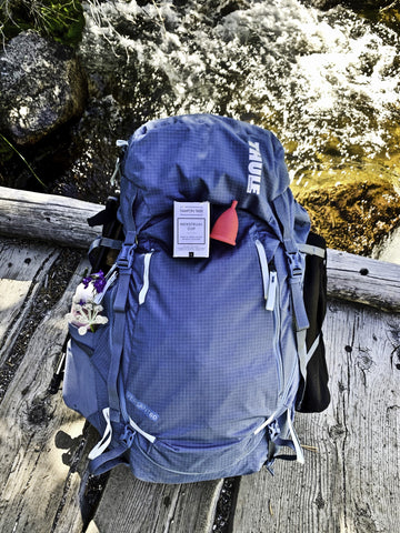 Tampon Tribe Menstrual Cup Sitting On Backpack During Hiking Trip