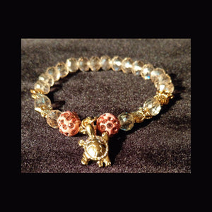 Bling sparkle light pink crystal beaded bracelet with turtle detail