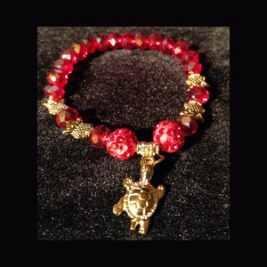 Sparkling red crystal beaded bracelet wtih turtle charm