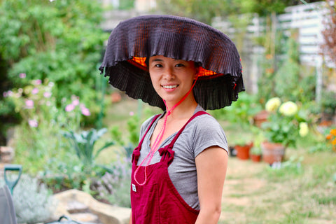 """""""This picture was taken in my old garden in the summer wearing a traditional Hakka hat called a leung mao, identical to the one my grandma wore when she was a rice farmer."""""""