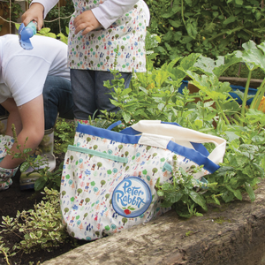 Peter Rabbit Kids Outdoor Bag Lifestyle shot in garden