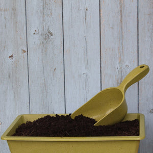 Haxnicks Bamboo Scoop Sage Green Biodegradable Compostable Sustainable Fibre Free From BPA Laying In Compost Tray