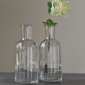Grand Illusions Ripple Glass Bottle Flower Vase Juice Water Wine. Lovely fluted glass bottles for your home-made drinks and cordials, or as a vase for your allotment or garden flowers. With a very decorative rippled glass body and elegantly shaped neck