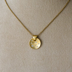 Concave 18 kt Gold Disk Pendant with Diamonds