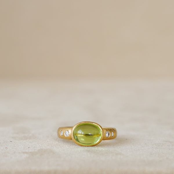 Peridot Cabochon Ring with Diamond Band