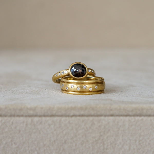 Black Diamond set in hand hammered 18k gold with White Diamond  sprinkled band. Perfect Alternative Bridal or Engagement Ring