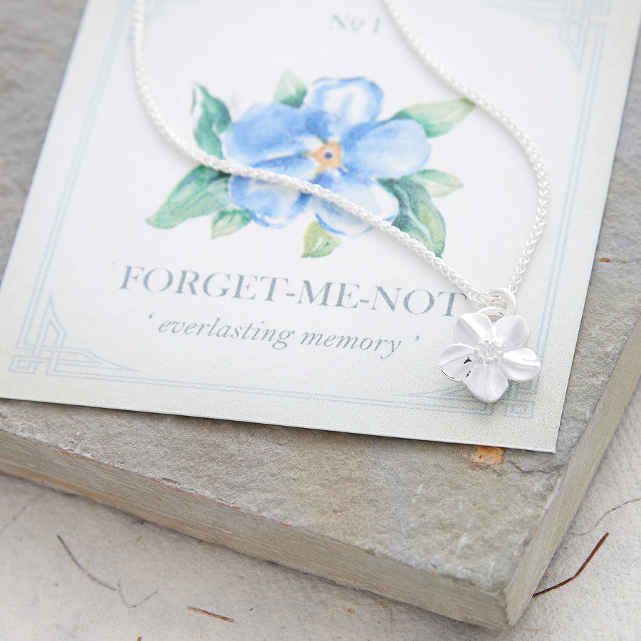 Silver forget-me-not flower necklace with heart on the back memorial gift slow fashion Chelsea Flower Show