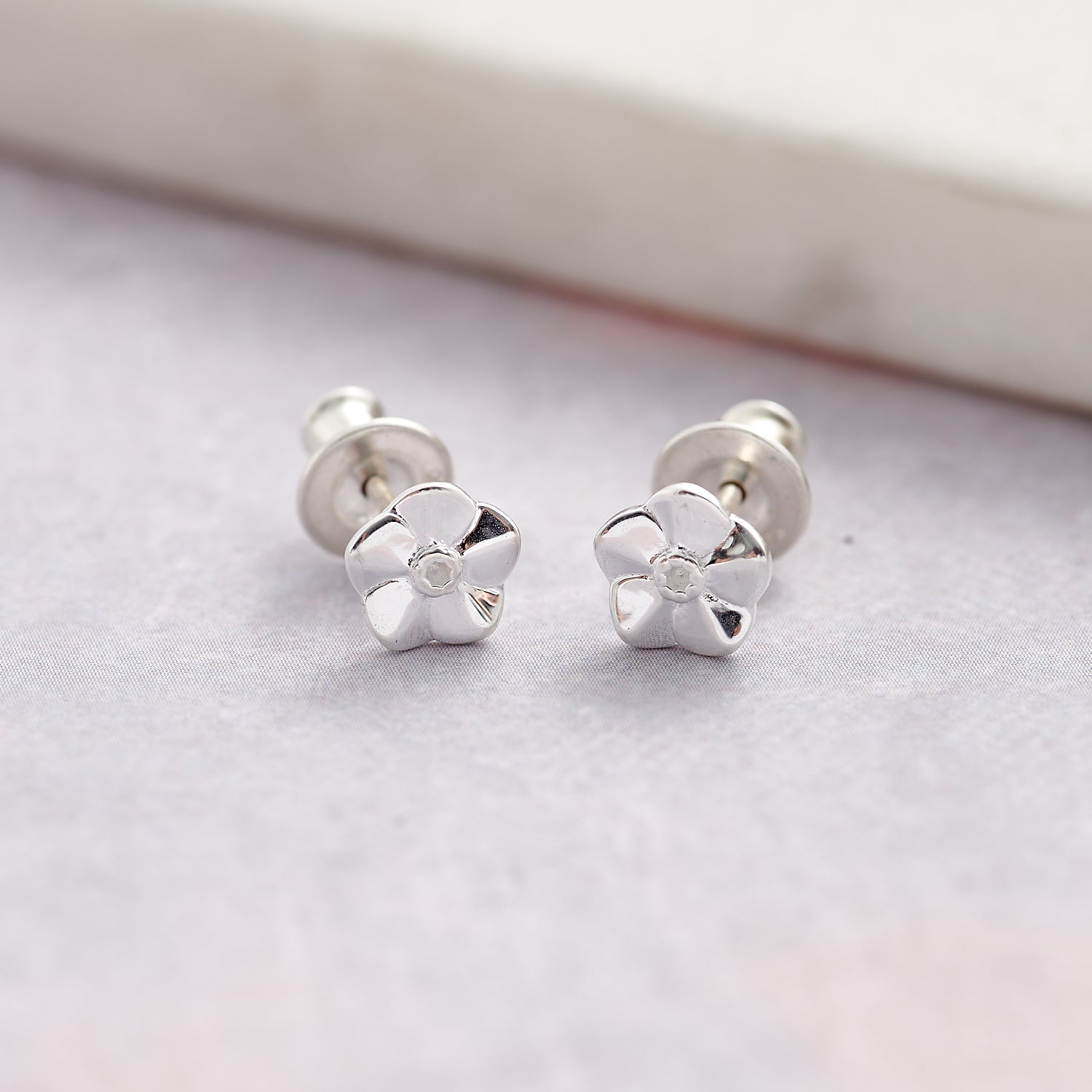 tiny silver forget me not flower stud earrings for women and girls scarlett jewellery brighton