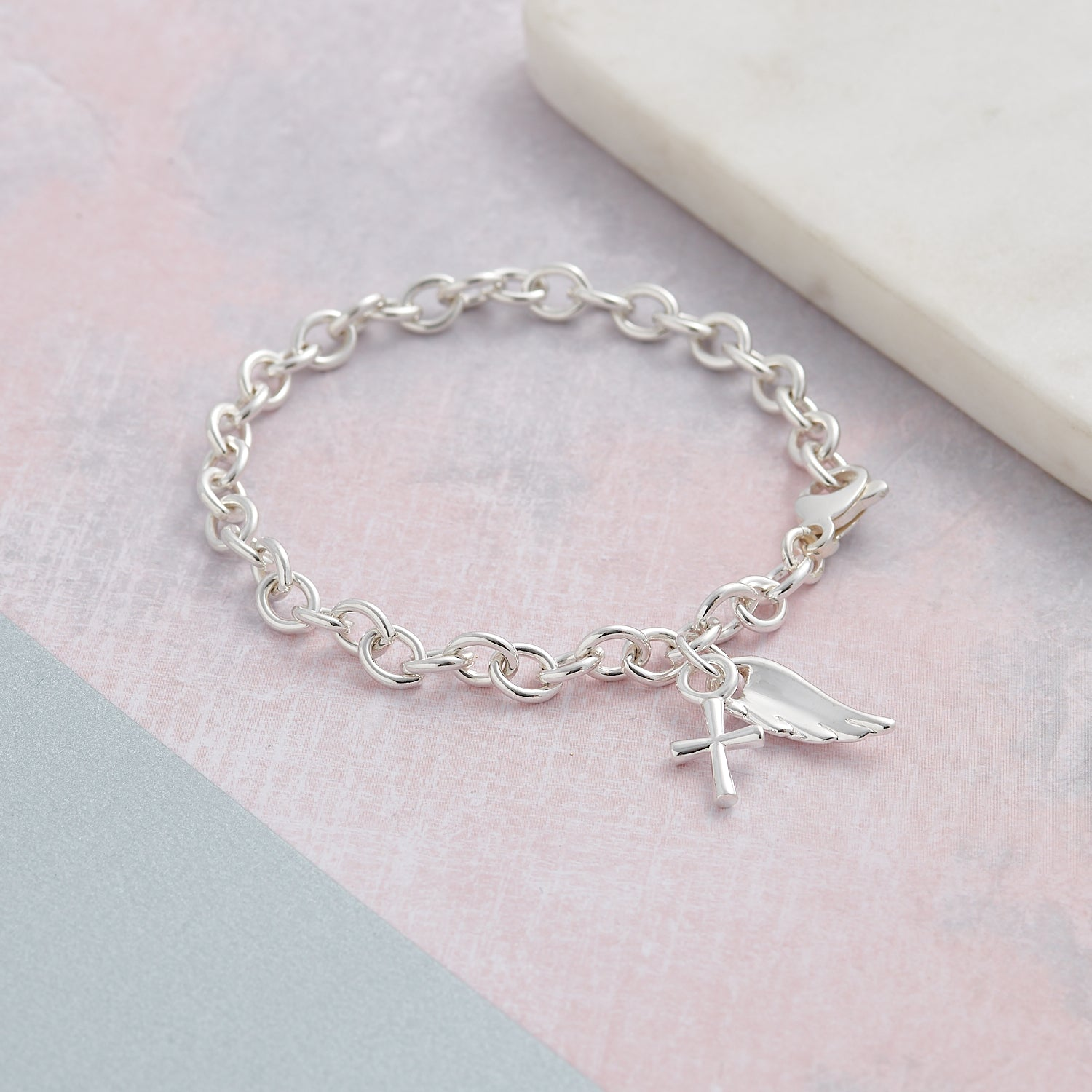 Solid sterling silver angel wing and cross christening charm bracelet designer Scarlett Jewellery