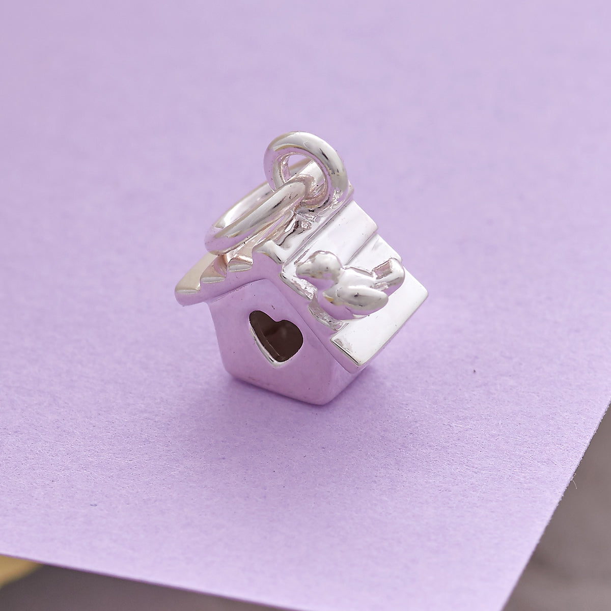 solid silver bird house charm with a heart shaped door and tiny bird FREE UK DELIVERY