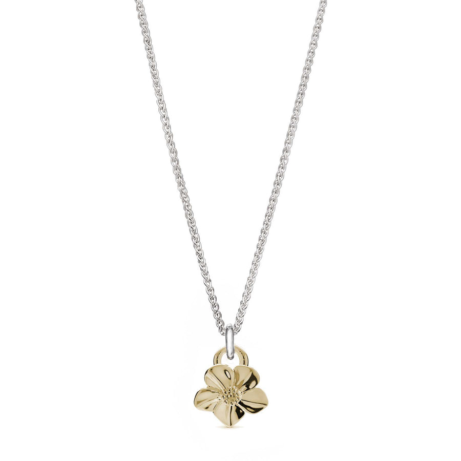 Solid gold forget-me-not flower necklace on silver chain designer Scarlett Jewellery Chelsea Flower Show