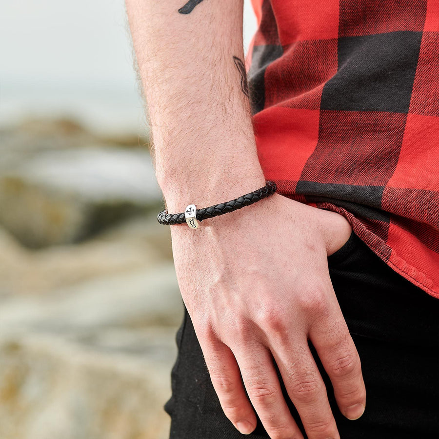 Unusual travel gift for men, chunky black leather bracelet with silver travel charm.