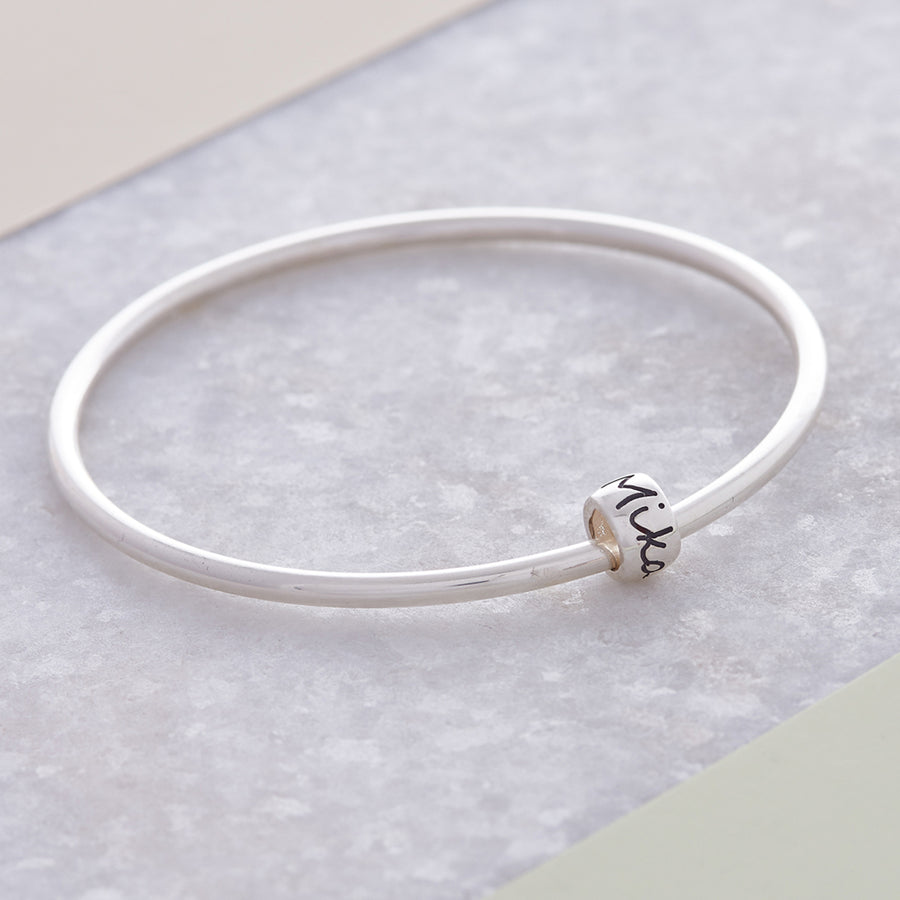 Personalised Silver Engraved Charm Bead Designer Charms on a silver bangle