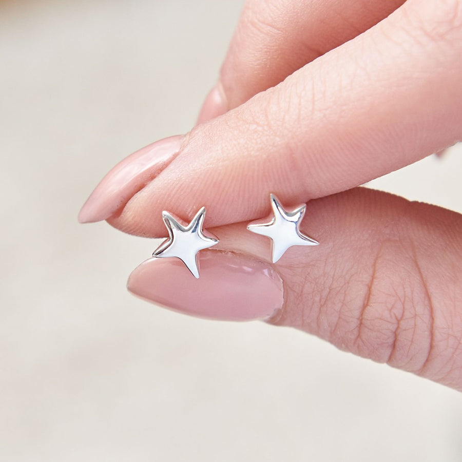 This beautiful, organic shaped pair of silver star studs from designer Scarlett Jewellery
