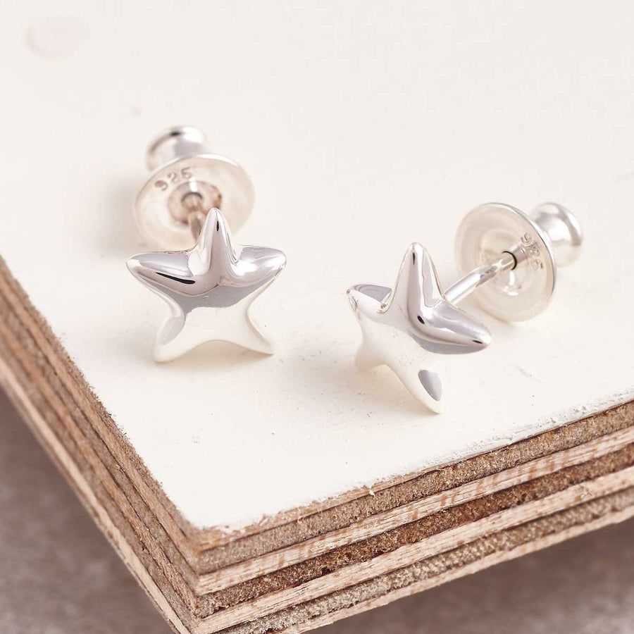 This beautiful, organic shaped pair of silver star studs from designer Scarlett Jewellery gift for woman