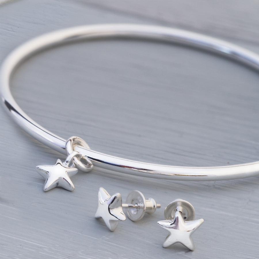 Silver star charm bangle designer and matching star earrings jewellery Scarlett Made in Brighton UK