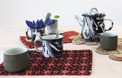 made century table mats with bornn enamelware black and white teapot and denby vintage cups