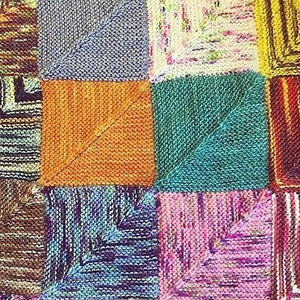 Close up of knitted squares in various colours