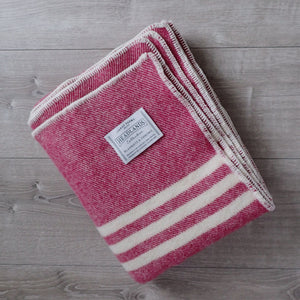 Fuchsia tweed wool blanket with white stripes and white edging, Topsy Farms' logo in one corner