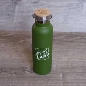 Green stainless steel Connect to the Land water bottle, with Topsy Farms logo burned into wooden top