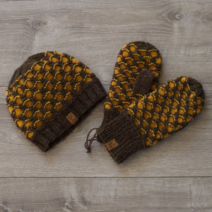 Knitted brown and gold toque and mittens in a honeycomb pattern