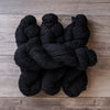 Black skeins of yarn.