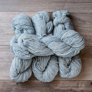 Blue Tweed skeins of yarn.