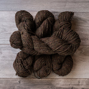 Brown Heather skeins of yarn.