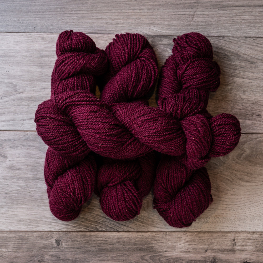 Burgundy skeins of yarn.