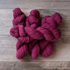 Fuchsia skeins of yarn.