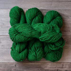 Green Kelly skeins of yarn.
