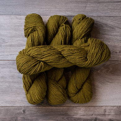 Green Olive skeins of yarn.