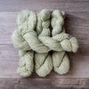 Green Tweed skeins of yarn.