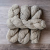 Grey and White skeins of yarn.