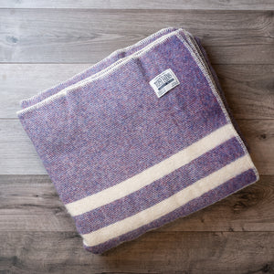 Folded wool blanket in purple heather tweed with 2 white stripes